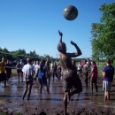 Throwing Up a Serve in Mud Volleyball